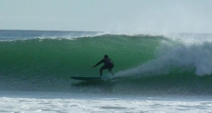 Photo of Bill Acevedo surfing